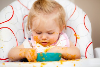 Little girl having a messy lunch